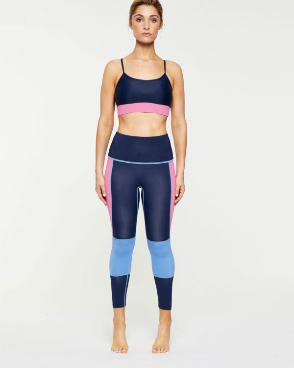 Femininely INFRASPINATUS Navy ACTIVE TOP WITH CONTRAST pink UNDER BUST BAND & ADJUSTABLE STRAPS, WORN WITH GRACILIS 7/8 LENGTH LEGGING, FRONT VIEW, great for Pilates and in-studio workouts